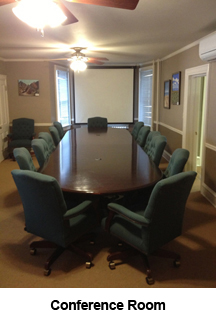 Conference Room with projector screen.