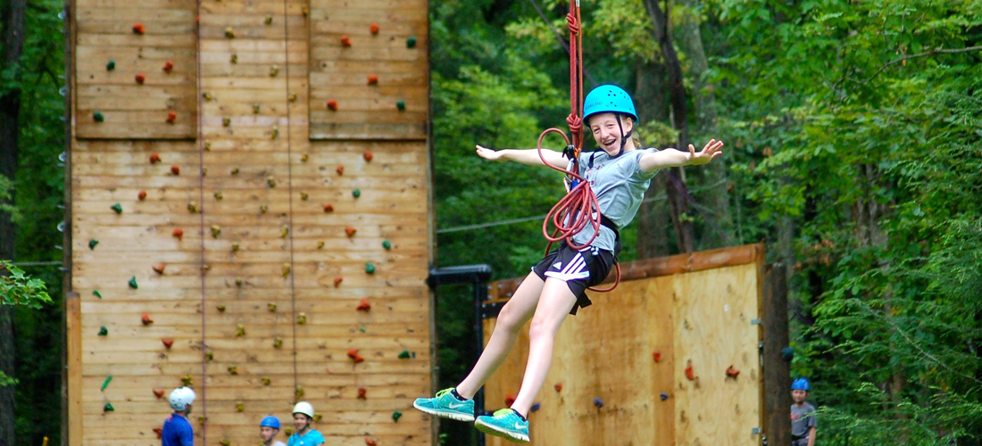 Girl ziplining at Blue Mountain Resort.