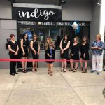 Ribbon cutting ceremony outside of Salon Indigo.