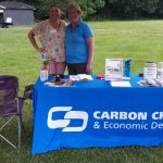 Alice Wanamaker and Kathy Henderson of the CCEDC at the Chamber table.