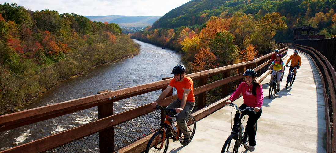 Bikers on D&L Trail in Fall in Carbon County PA.