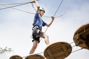 Young teen on ropes course at Blue Mountain Resort.