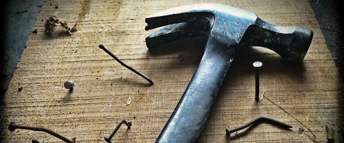 hammer and nails in board