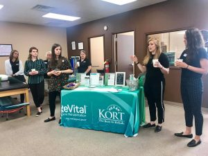 Kort giving a presentation during their breakfast.