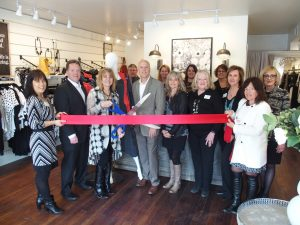 ribbon cutting at botique