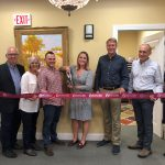 Lindsey Cumoletti MS, RDN, with scissors, at her ribbon cutting ceremony.