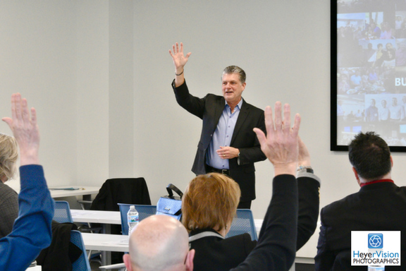 Ambassadors for Business president, Bob Willbanks, leads an interactive presentation at an event.