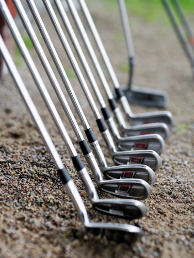 picture of golf clubs stacked in a row
