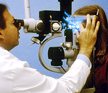 image of eye doctor viewing clients eyes through lens