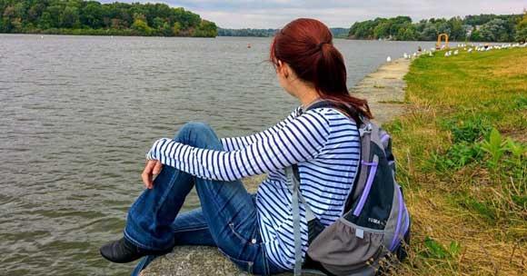 woman sitting by riverside