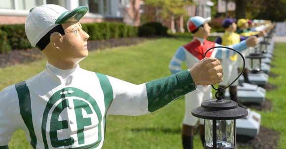 Statues of jockeys in a row