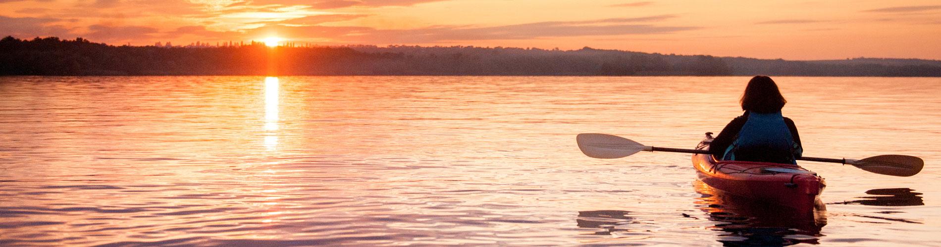 kayaking on lake at sunset