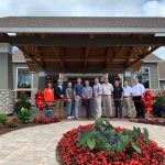 ribbon cutting event with chamber members outdoor cutting a ribbon