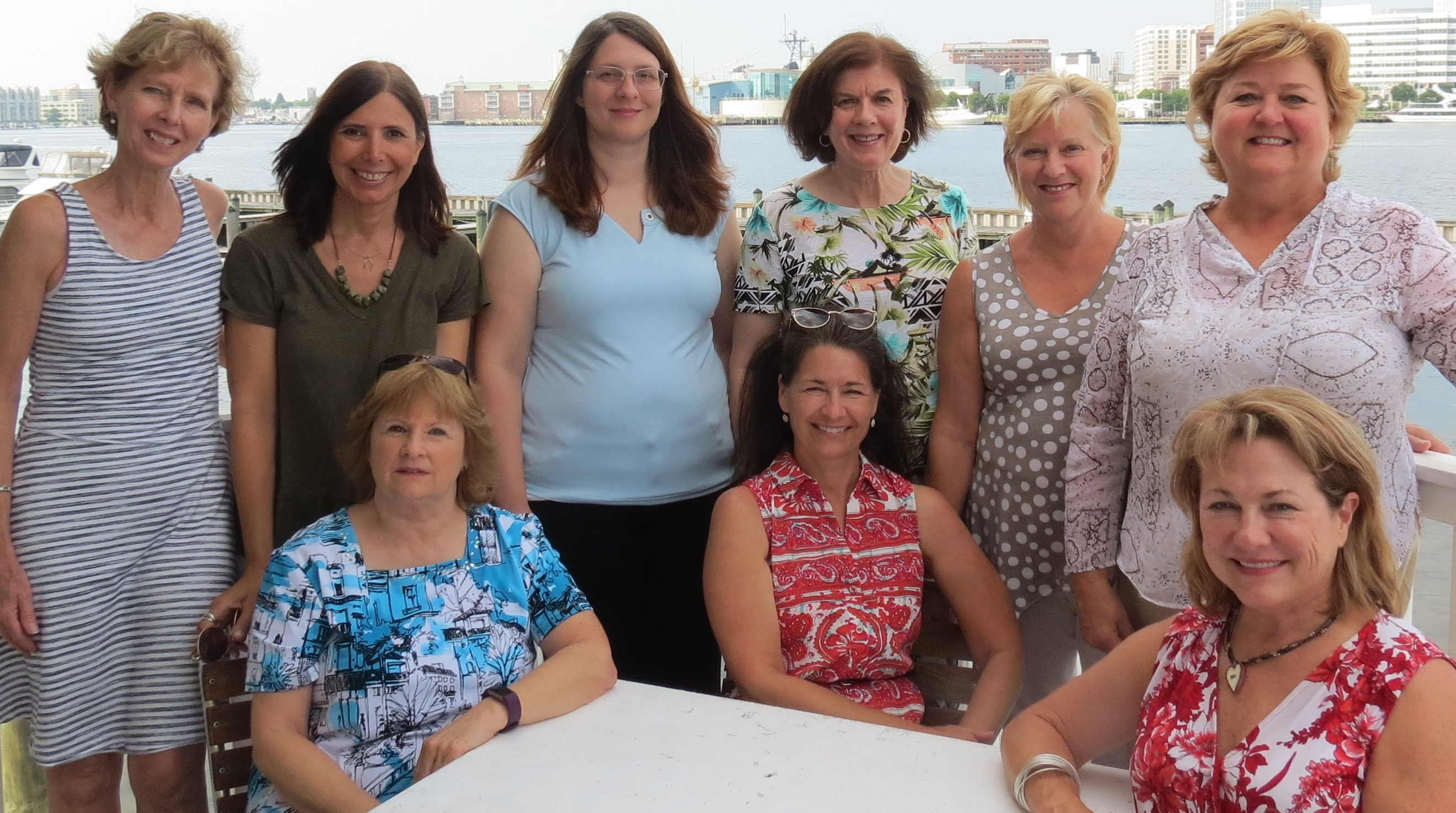 Standing (left to right) Joyce Hearn, COO; Laura Williamson; Tammy Nobles; Michelle Richards; Kathy Ward; Claudia Cotton, CEO Seated (left to right) Teresa Howell; Dee Fain; Betty Axson