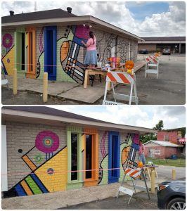Local artist paints bright mural on Arts Counci building