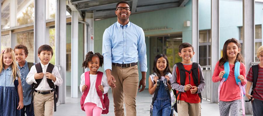 Kids walking with teacher