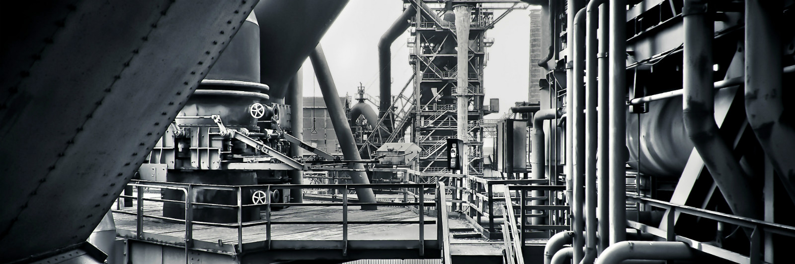 black and white factory pipes