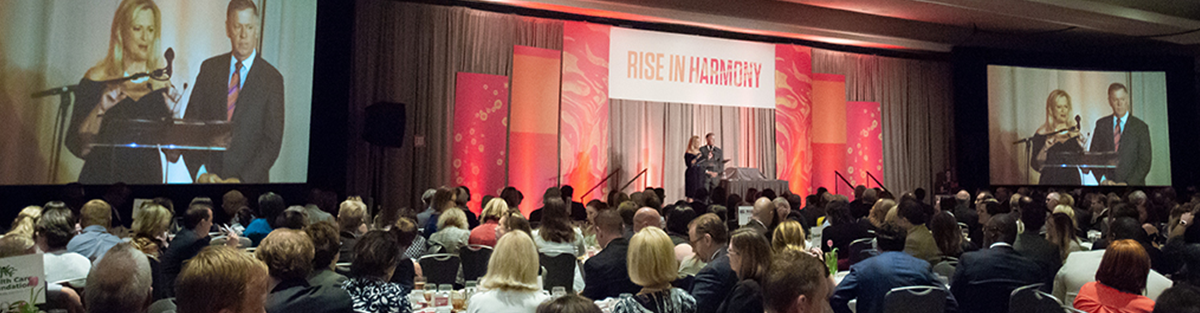 Picture of 2018 Philanthropy Awards Luncheon Stage with Mary and Mark Thompson of Country Club Bank