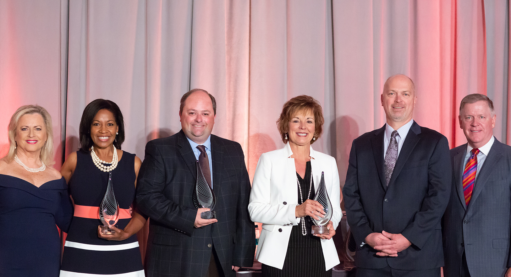 2018 Philanthropy Award Honorees smiling with awards