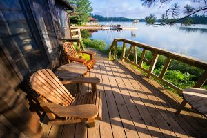 Chairs sitting on porch of lake rental home