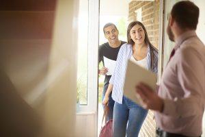 Landlord welcoming new tenants
