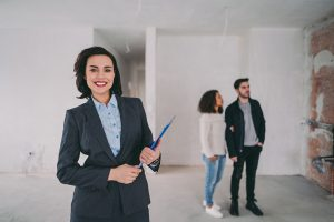 Real estate agent with potential buyers