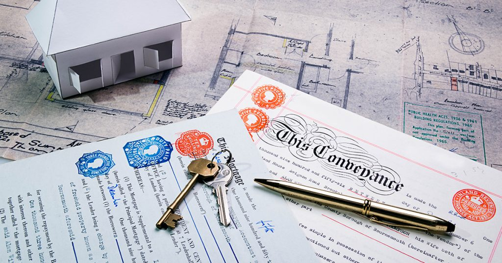 Property and Mortgage deeds sit on top of plans