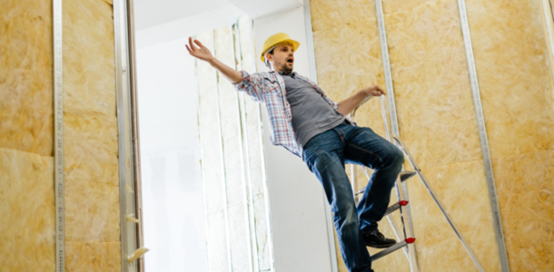A construction worker falling off a ladder