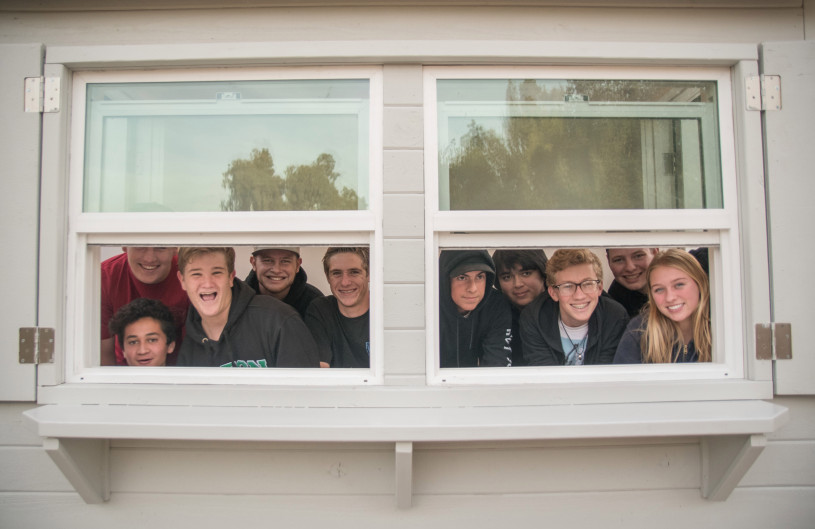 Some of the 60 students from Brea Olinda High School's Building Industry Technology Academy look out from the volunteer kiosk that they built for the Fullerton Arboretum. (Photo by Michael Kitada, Contributing Photographer)