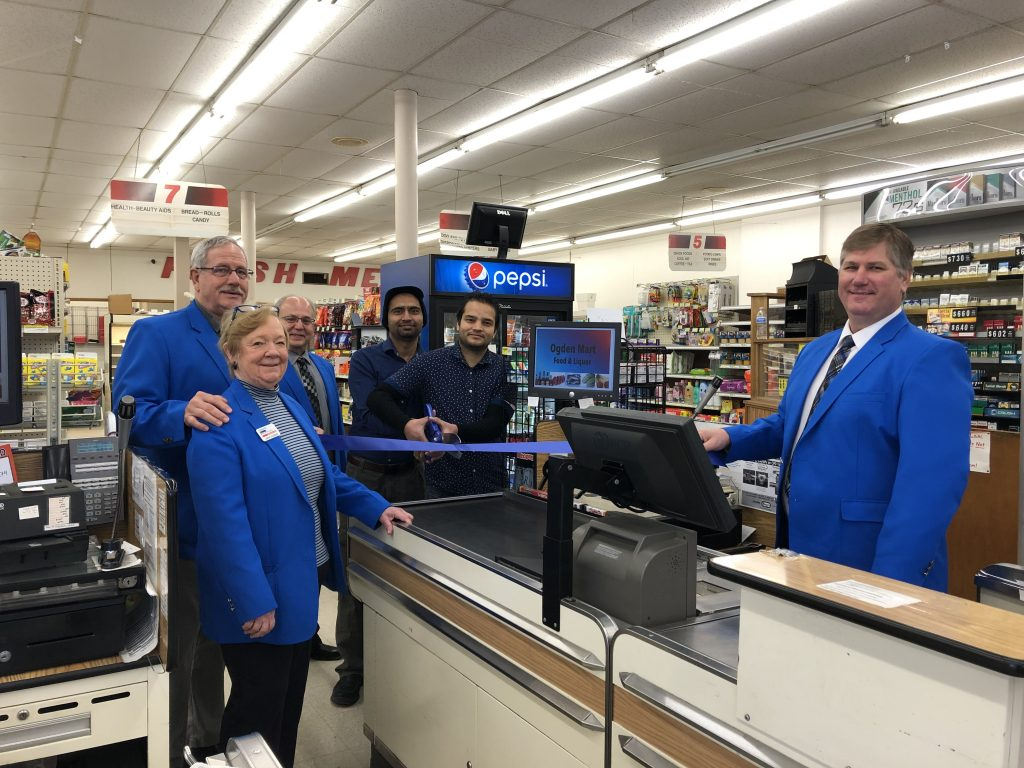 Chamber Ambassadors with the new owners of Ogden Market (302 W. Walnut Street) cut a ribbon on January 17, celebrating the re-opening of the grocery store.