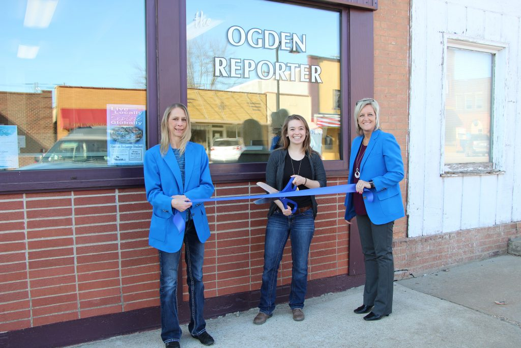 Ogden Ambassadors with Corinne Wetzel, Editor of The Ogden Reporter (222 W Walnut Street) cut the ribbon on March 21, celebrating the new staff.