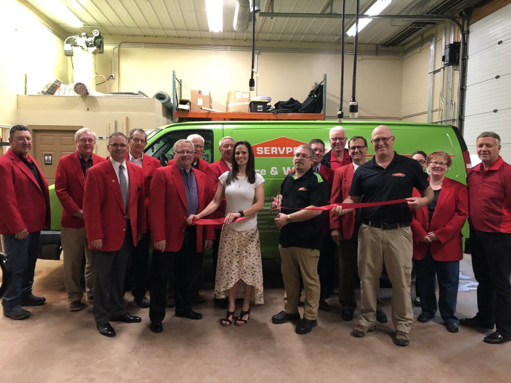 The owners and staff of ServPro of Ames (2316 230th Street) and Chamber Ambassadors celebrated with a ribbon cutting on May 14.