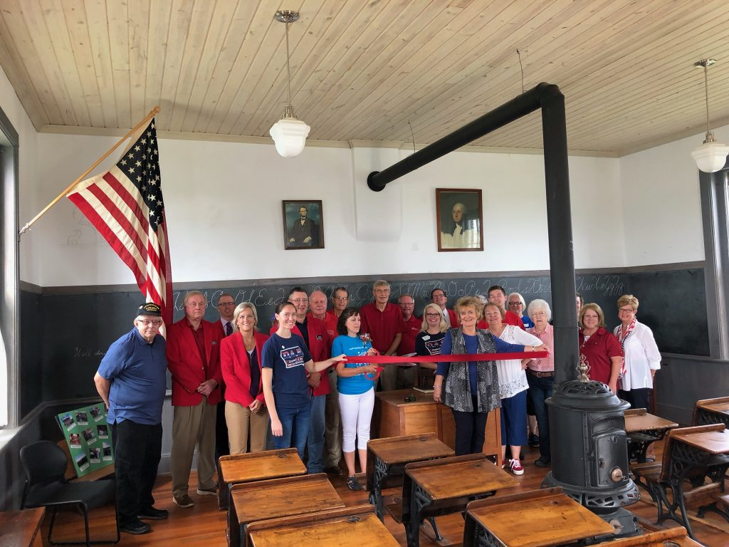 Chamber Ambassadors and volunteers of Cole Schoolhouse (843 R Avenue) cut the ribbon to celebrate being named on the National Register of Historic Places July 13.
