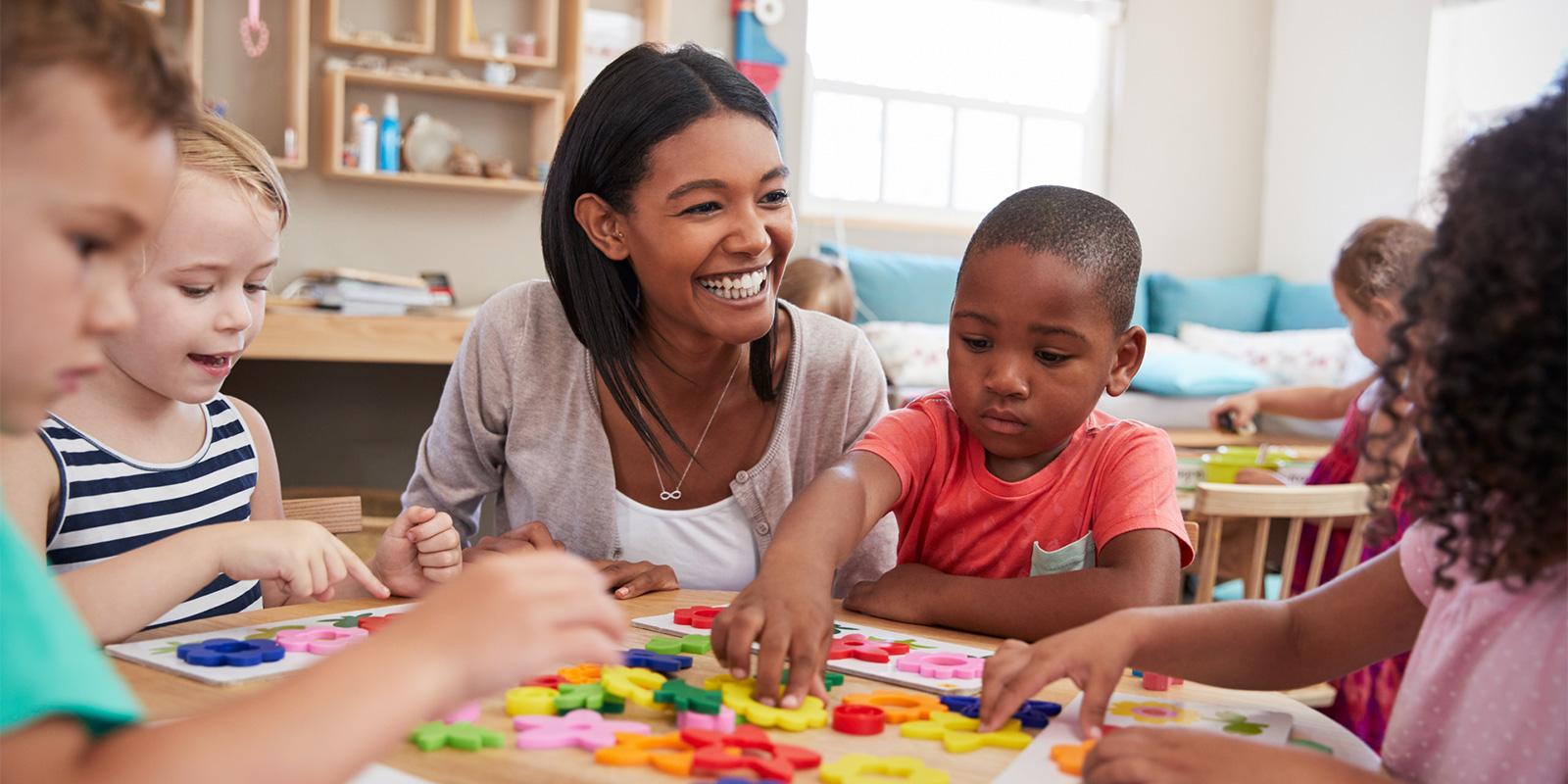 teacher-with-kids-in-preschool