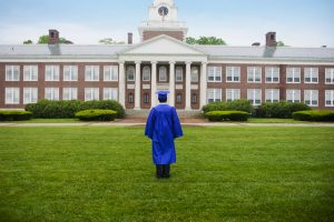 College Graduate Looking At College Building --- Image by © Randy Faris/Corbis