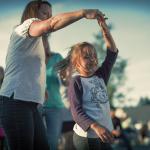 Mother & Daughter dancing at Riverwalk Summer Concert Series