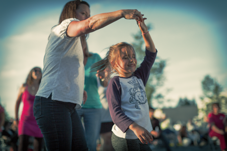 Mother & Daughter dancing at Riverwalk Summer Concert Series