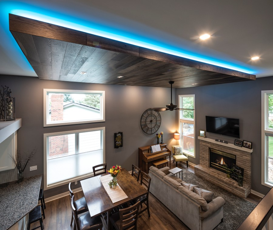 Family room remodel featuring custom neon lighting in ceiling areas