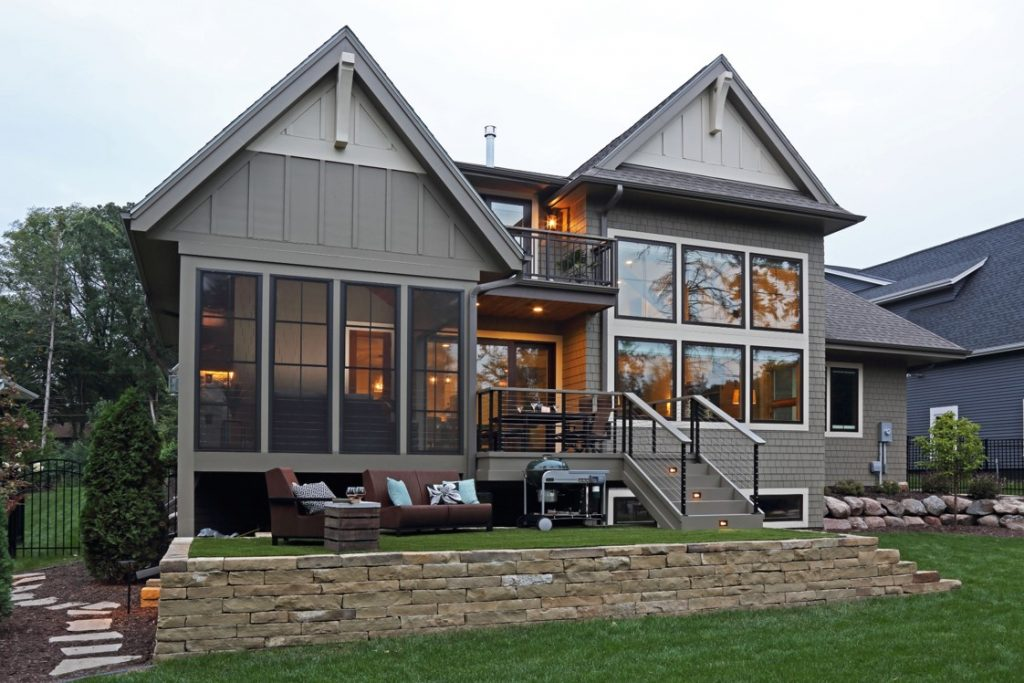 External lakeside remodel featuring windows
