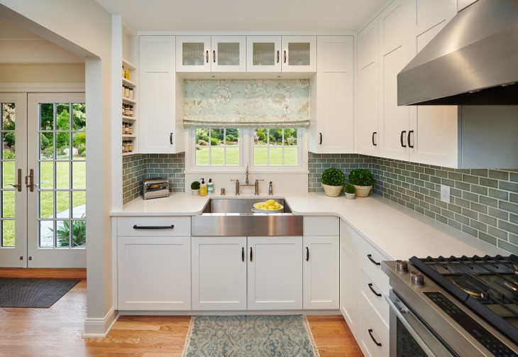 Kitchen remodel featuring white cabinetry