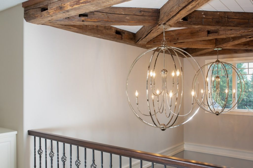 Foyer entry ceiling with large decorative beams