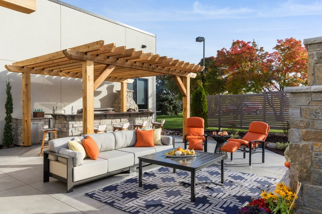 Outdoor patio space with furniture and wood pergola