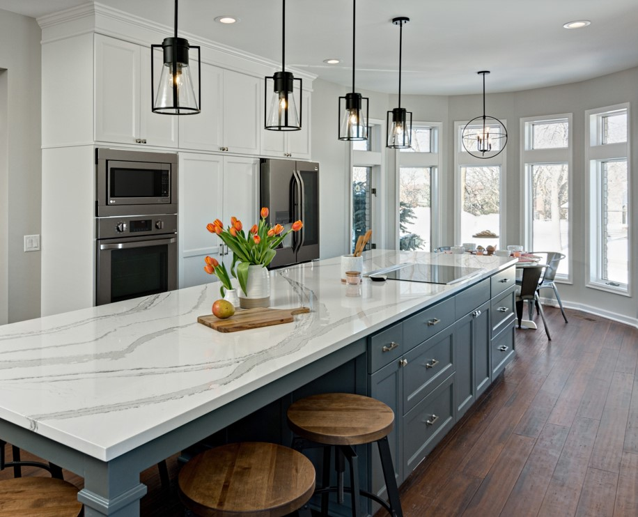 Kitchen remodel featuring large island with granite countertops