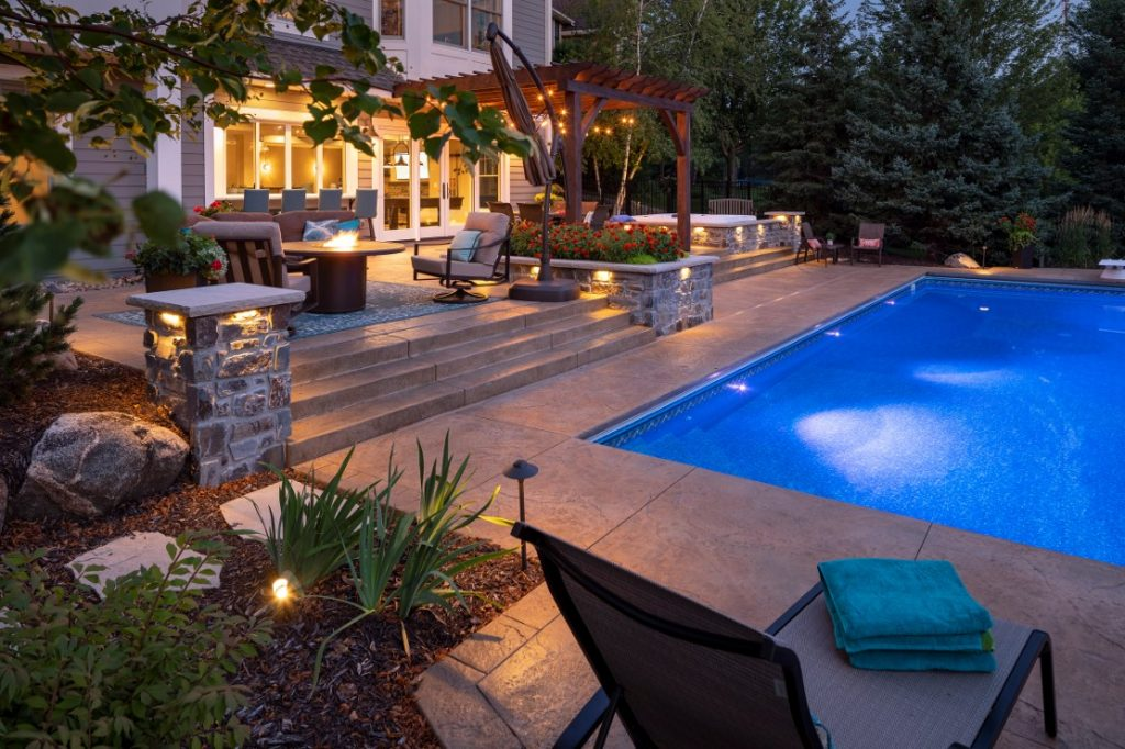 Outdoor remodel featuing pool