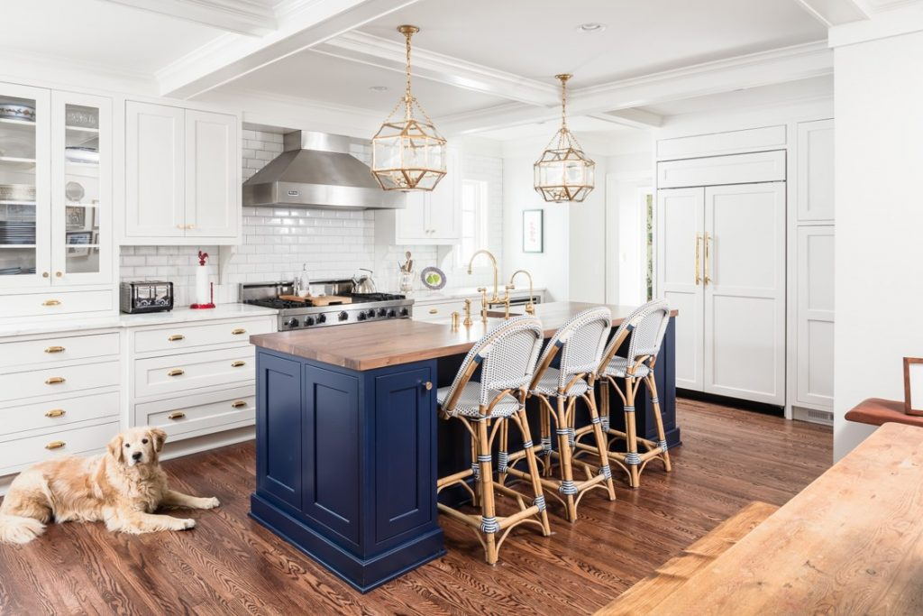 Kitchen remodel featuring navy blue island