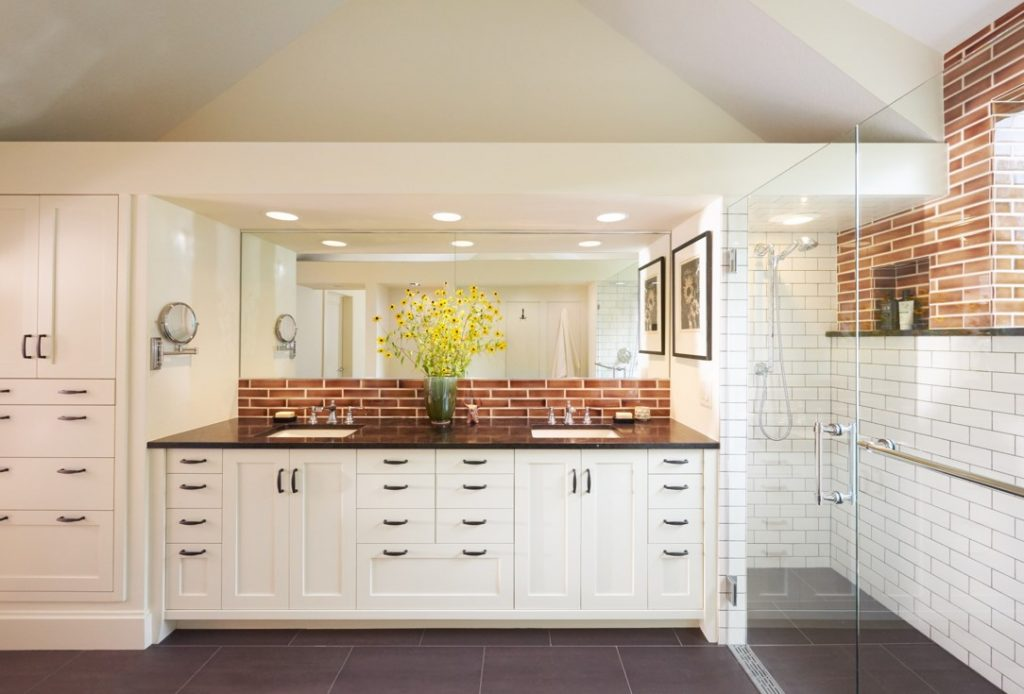 Bathroom remodel featuring his and hers sink area